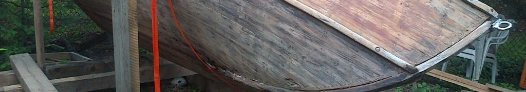 Outer hull stripped of fiberglass and 8+ coats of paint.